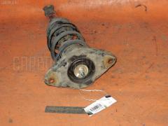 Стойка амортизатора Nissan Bluebird sylphy TG10 QR20DD Фото 1