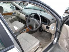 Стойка амортизатора Nissan Bluebird sylphy TG10 QR20DD Фото 9