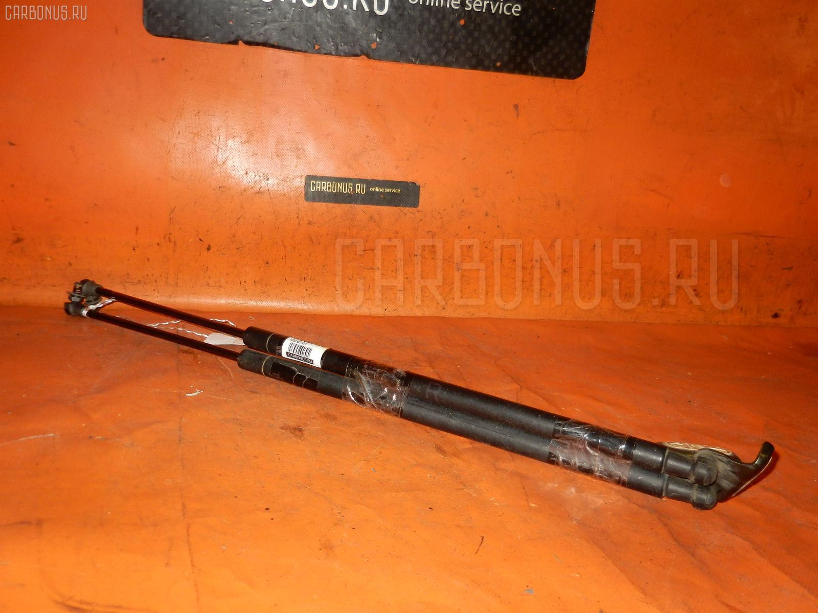 Амортизатор двери TOYOTA RACTIS SCP100 Фото 1