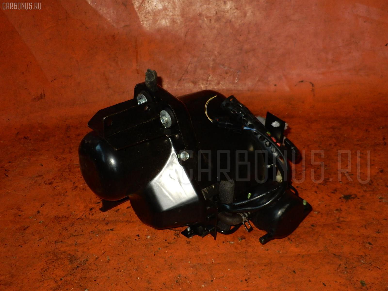 Стойка амортизатора TOYOTA RACTIS SCP100 2SZ-FE Фото 1