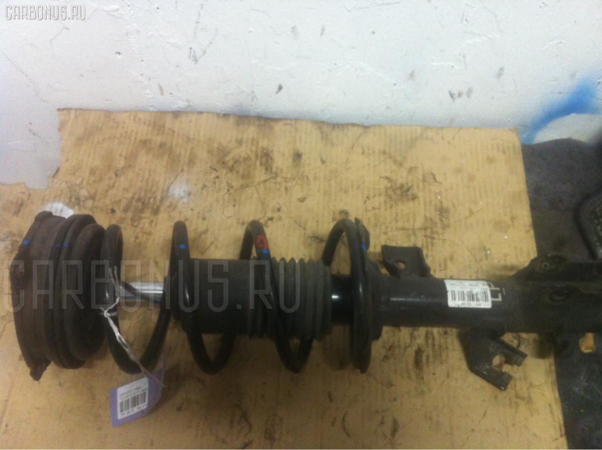 Стойка амортизатора Nissan Wingroad Y12 HR15-DE Фото 1