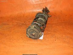Стойка амортизатора Nissan Wingroad Y12 HR15-DE Фото 2