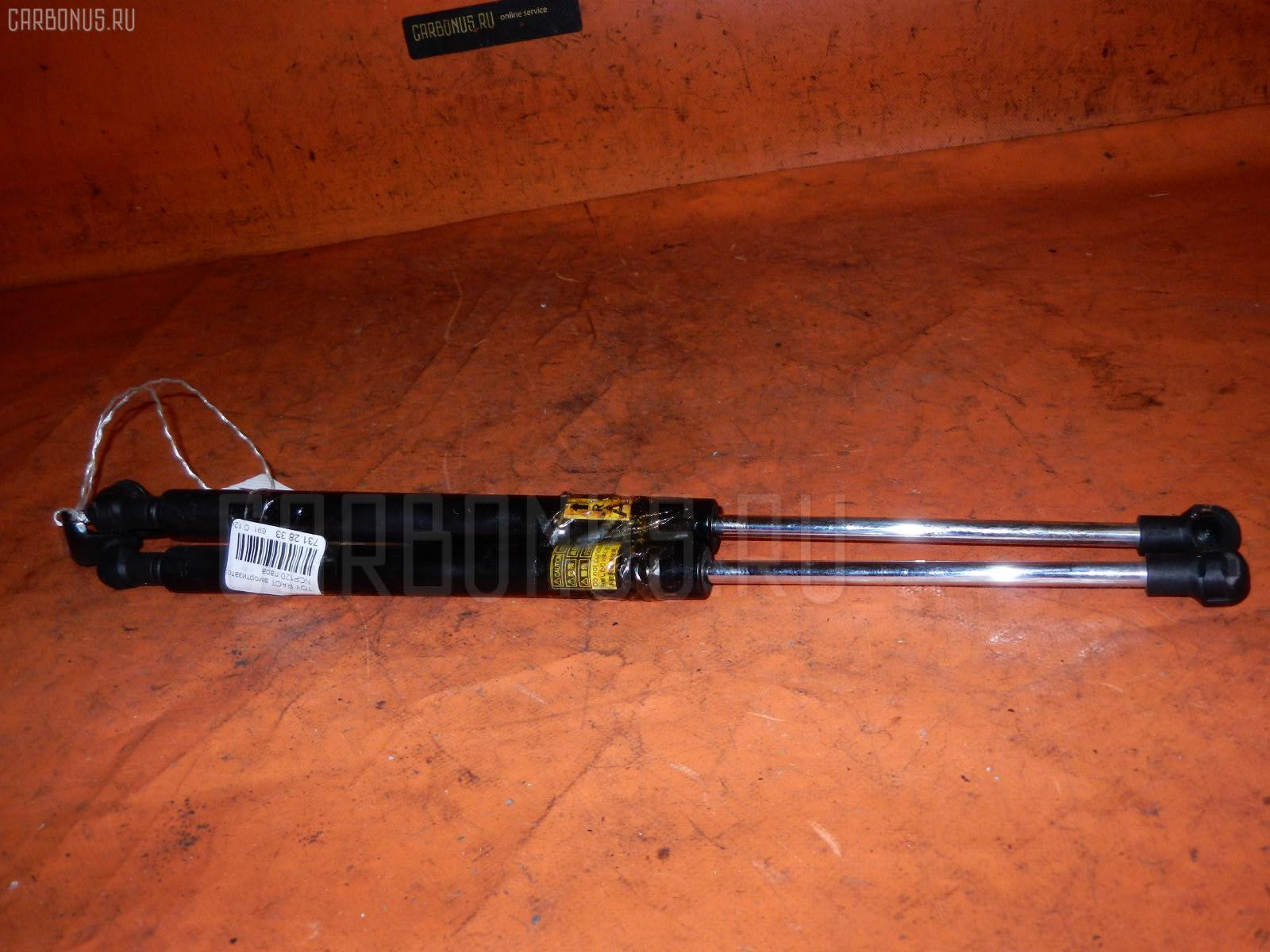 Амортизатор двери TOYOTA RACTIS NCP120 Фото 1