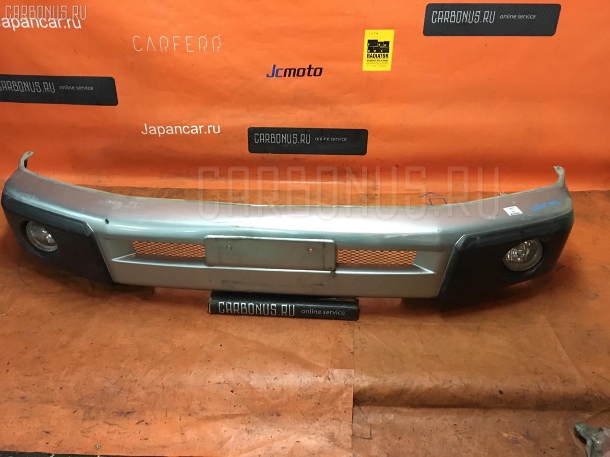Бампер Mitsubishi Pajero io H66W Фото 1