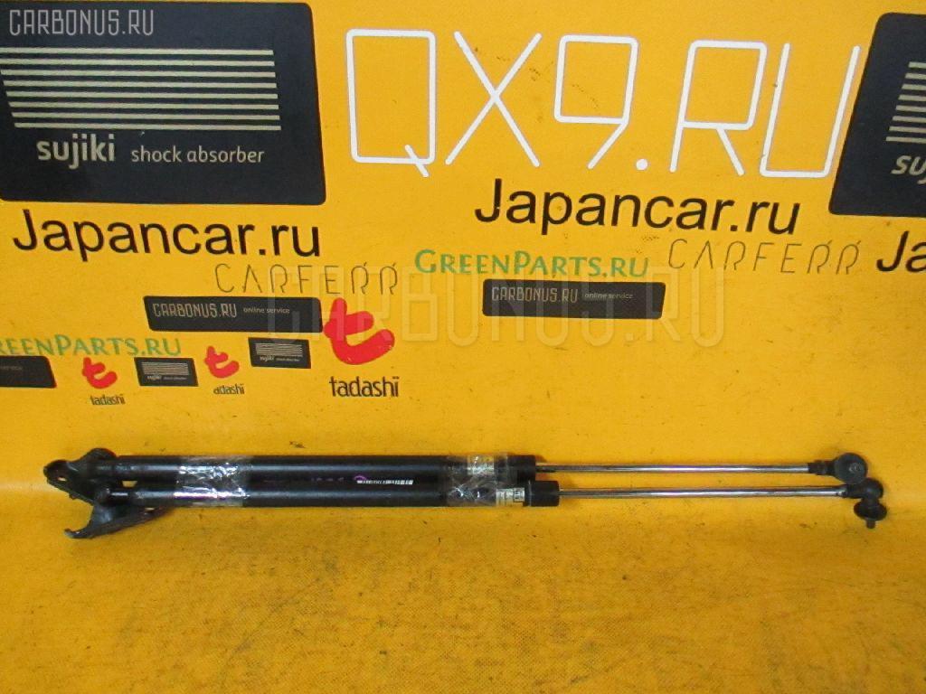 Амортизатор двери Toyota Probox NCP50V Фото 1