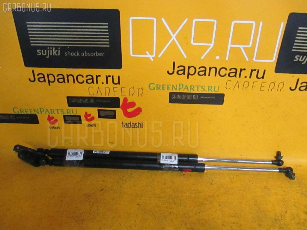 Амортизатор двери Toyota Bb NCP31 Фото 1