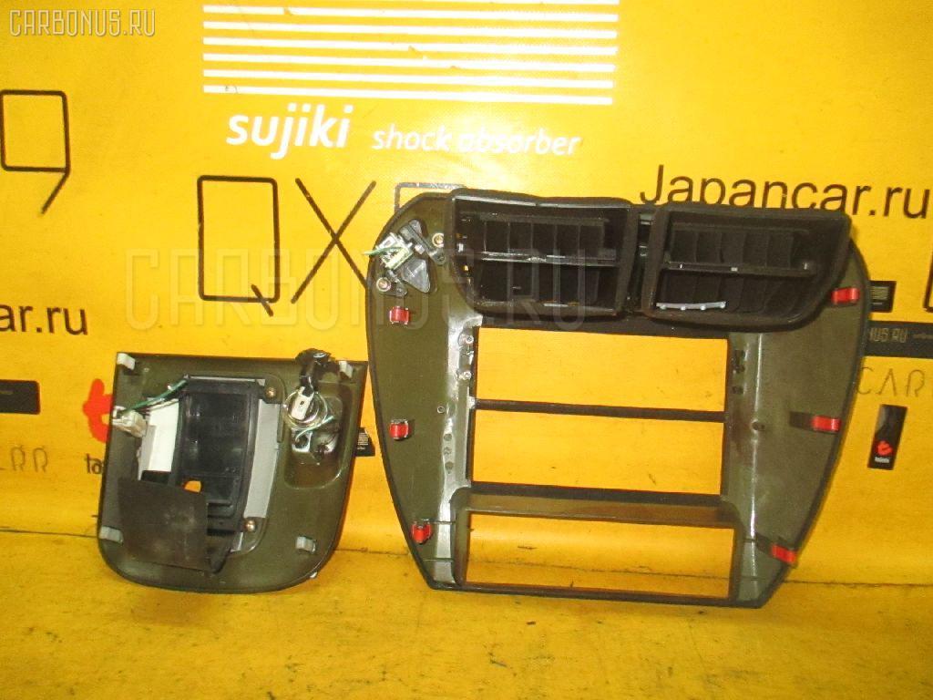 Консоль магнитофона MITSUBISHI CHARIOT GRANDIS N84W. Фото 11