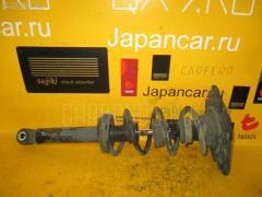 Стойка амортизатора Nissan Primera TP12 QR20DE Фото 2