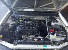 Амортизатор двери Nissan Avenir W11 Фото 3