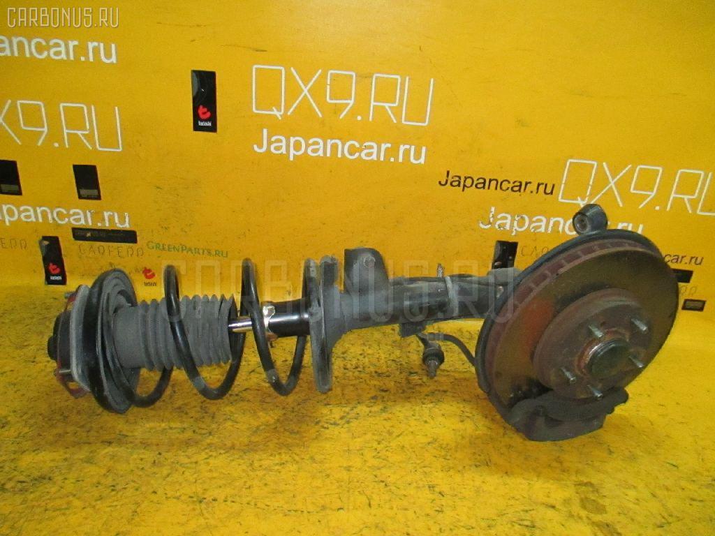 Стойка амортизатора NISSAN CEDRIC MY34 VQ25DD Фото 1