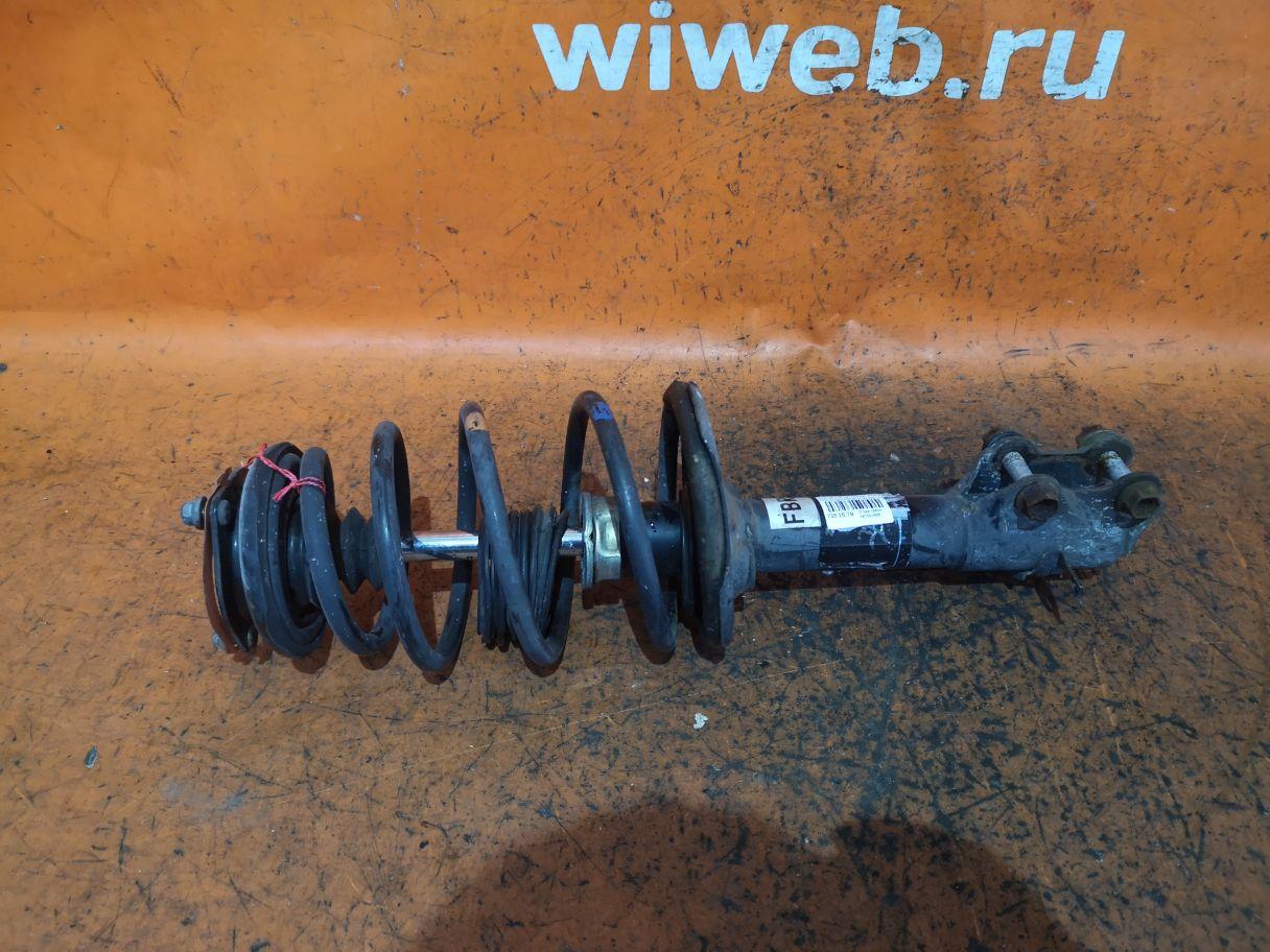 Стойка амортизатора на Nissan Bluebird Sylphy FG10 QG15DE Фото 1