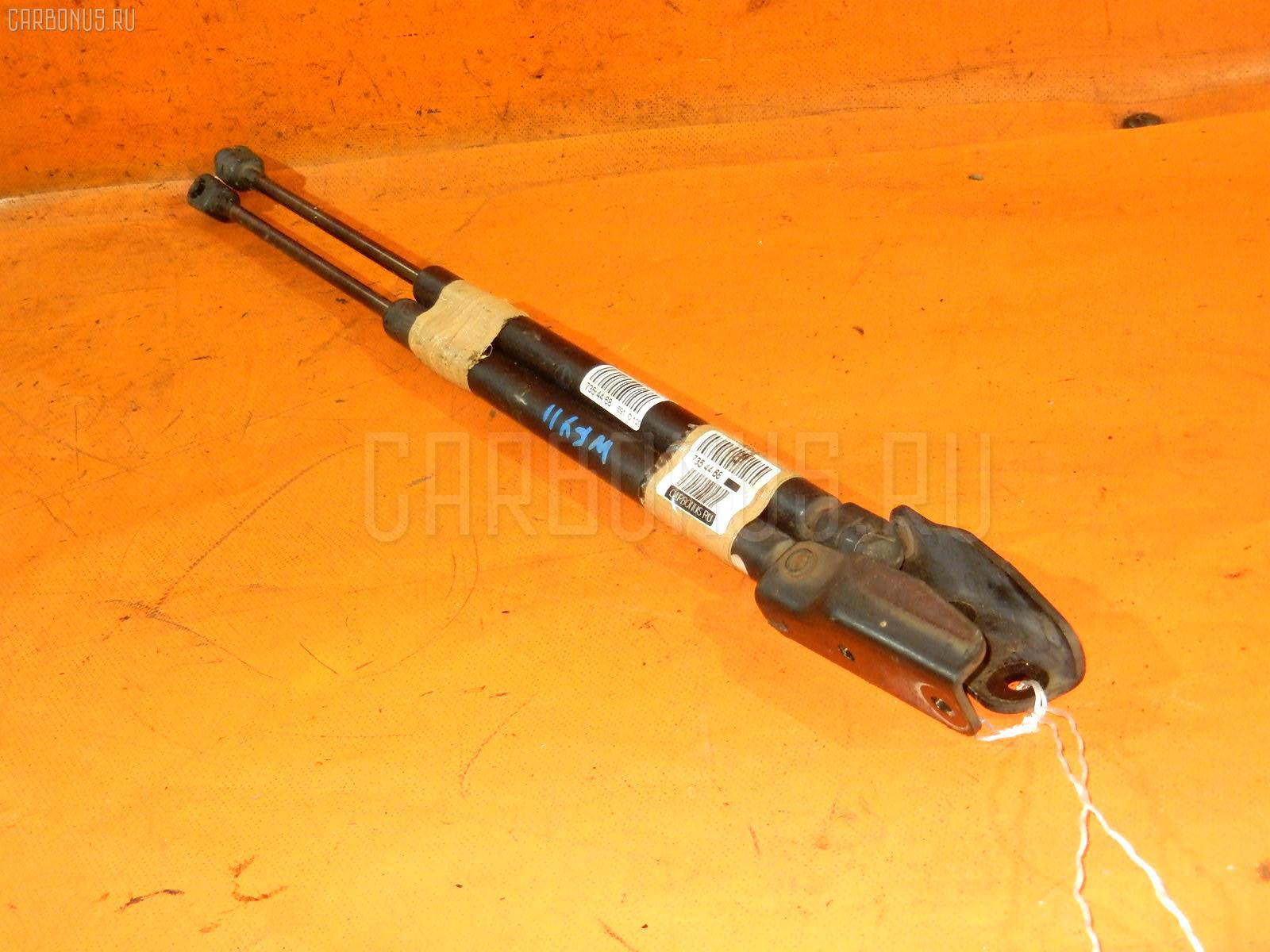 Амортизатор двери Nissan Wingroad WFY11 Фото 1