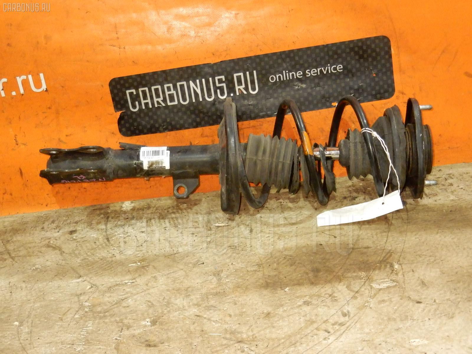 Стойка амортизатора TOYOTA COROLLA FIELDER NZE121G 1NZ-FE. Фото 4