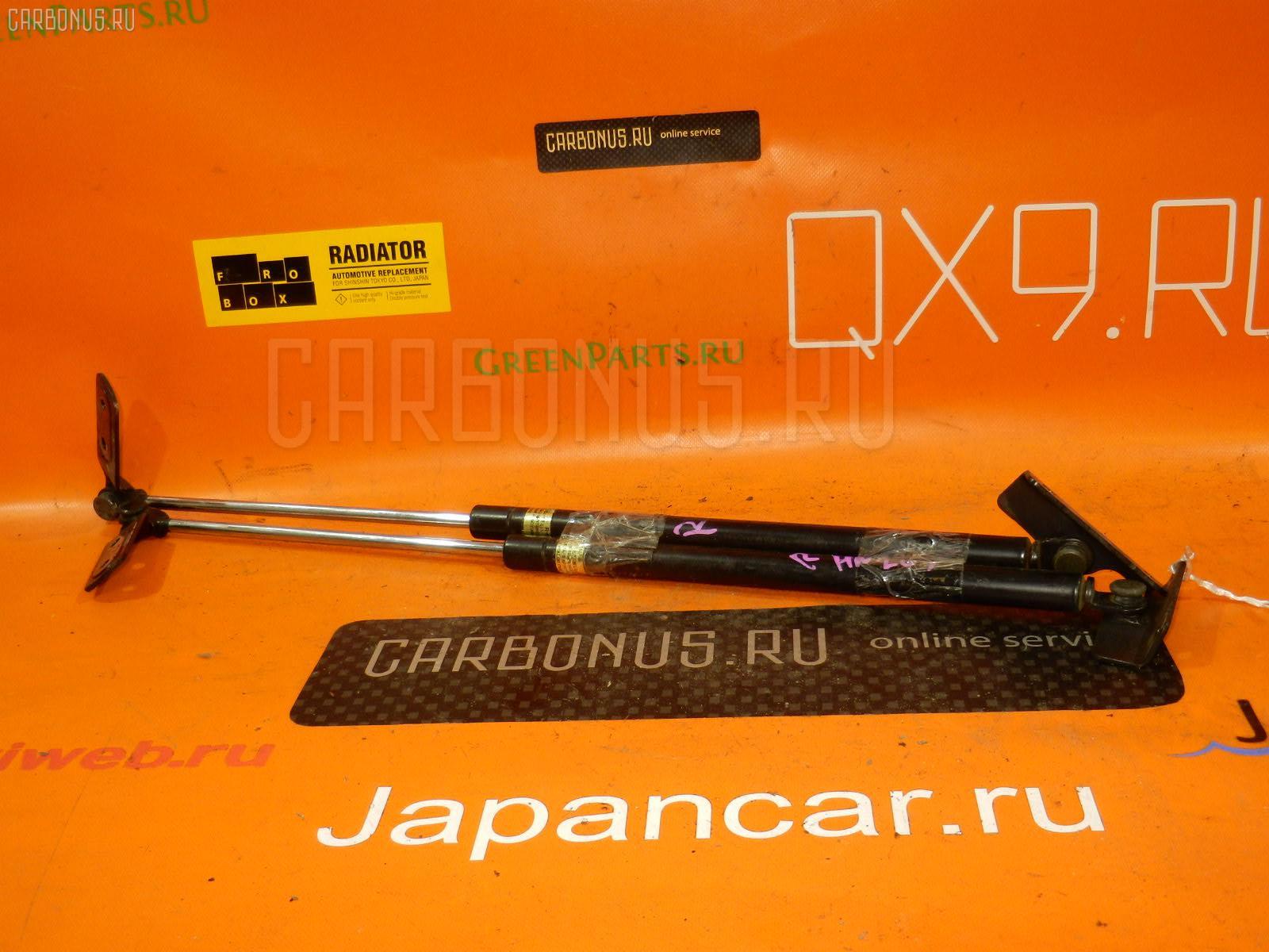 Амортизатор двери SUZUKI KEI HN22S Фото 1