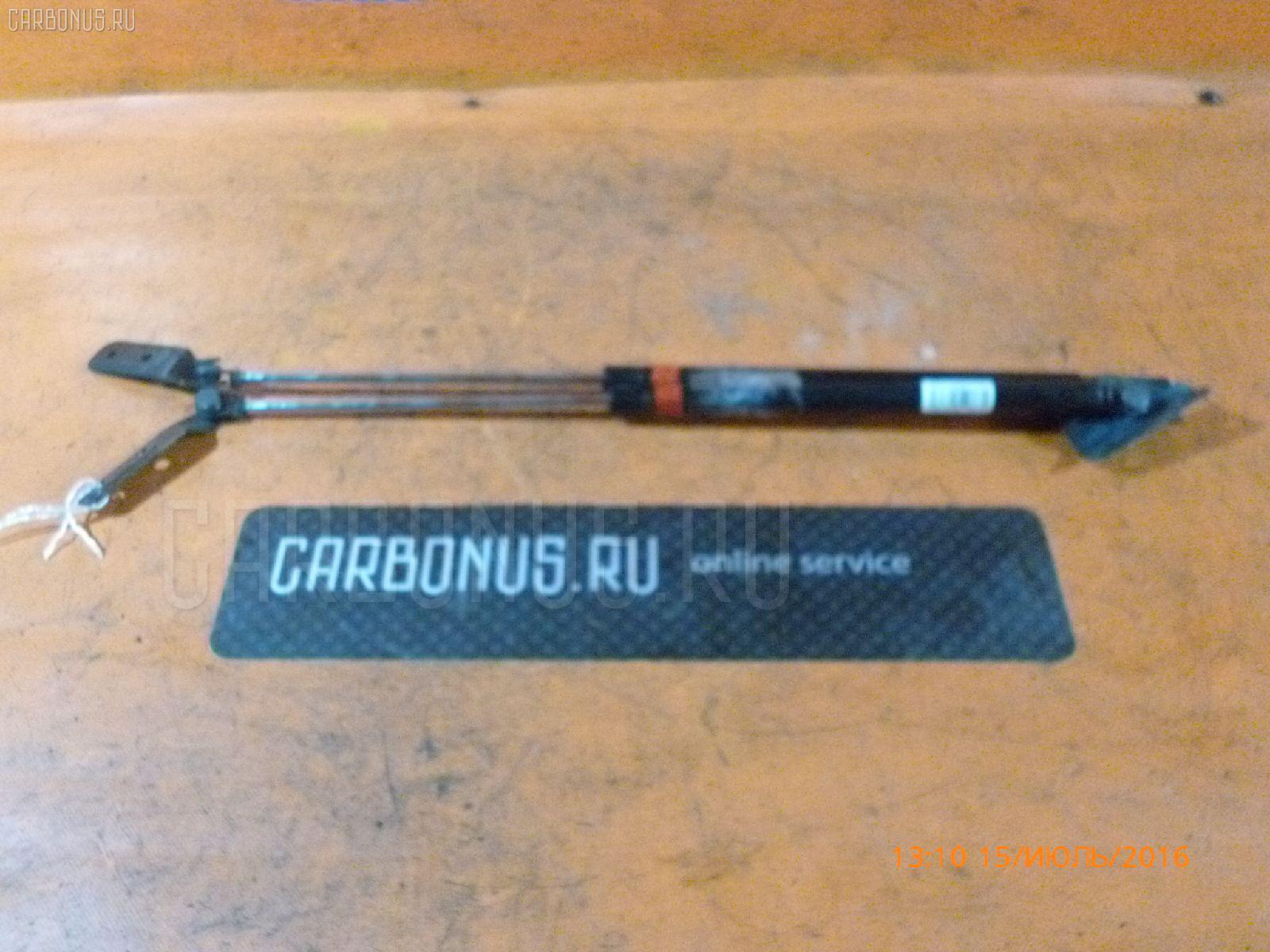 Амортизатор двери SUZUKI CHEVROLET CRUZE HR51S. Фото 6