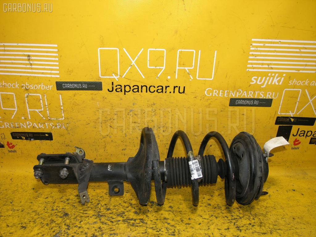 Стойка амортизатора Mitsubishi Grandis NA4W 4G69 Фото 1
