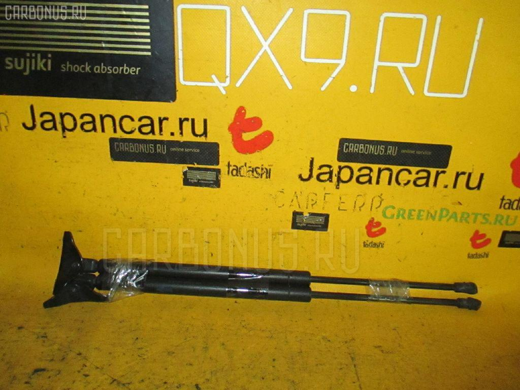 Амортизатор двери TOYOTA COROLLA RUNX NZE121 Фото 1
