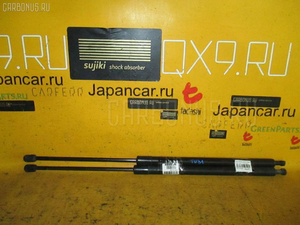 Амортизатор двери Nissan Presage TU31 Фото 1