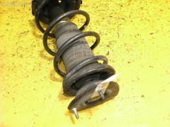 Стойка амортизатора Toyota Platz SCP11 1SZ-FE Фото 2