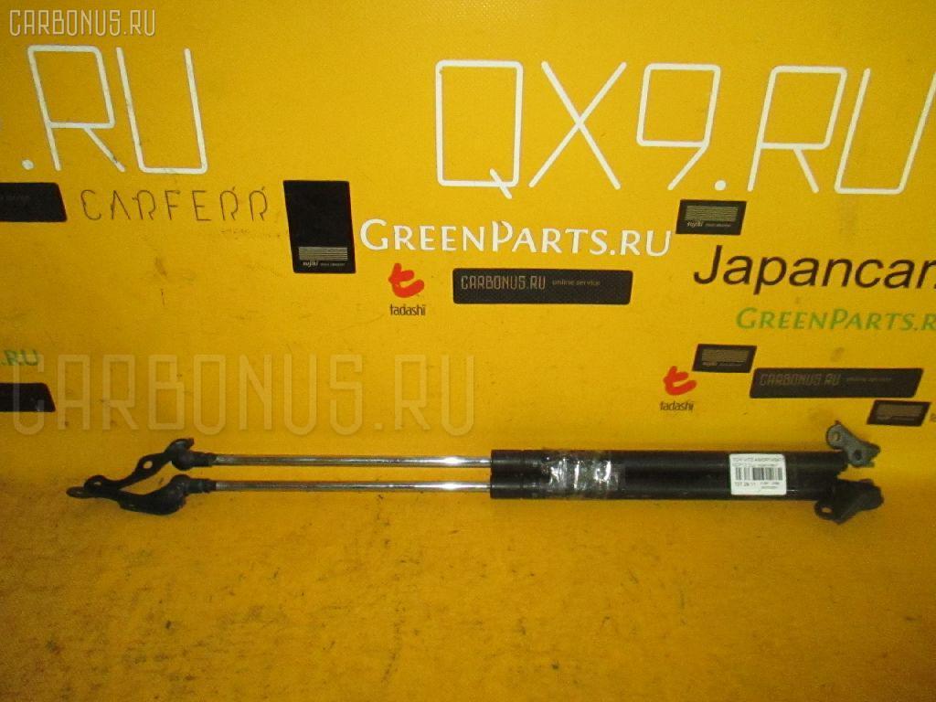 Амортизатор двери Toyota Vitz NCP10 Фото 1
