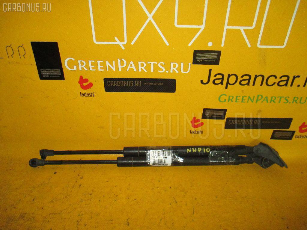 Амортизатор двери на Toyota Porte NNP10 Фото 1