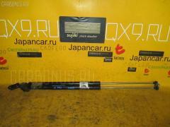 Амортизатор двери Nissan Avenir PW11 Фото 1