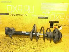 Стойка амортизатора NISSAN X-TRAIL NT30 QR20DE Фото 2