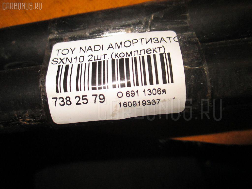 Амортизатор двери TOYOTA NADIA SXN10 Фото 2