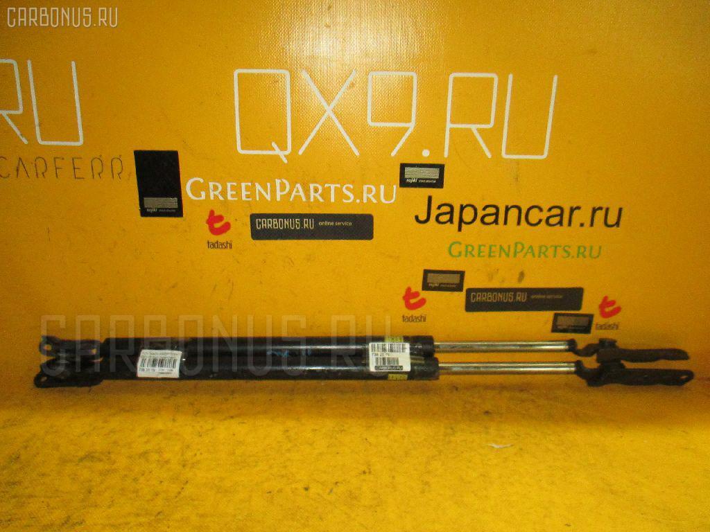 Амортизатор двери Toyota Nadia SXN10 Фото 1
