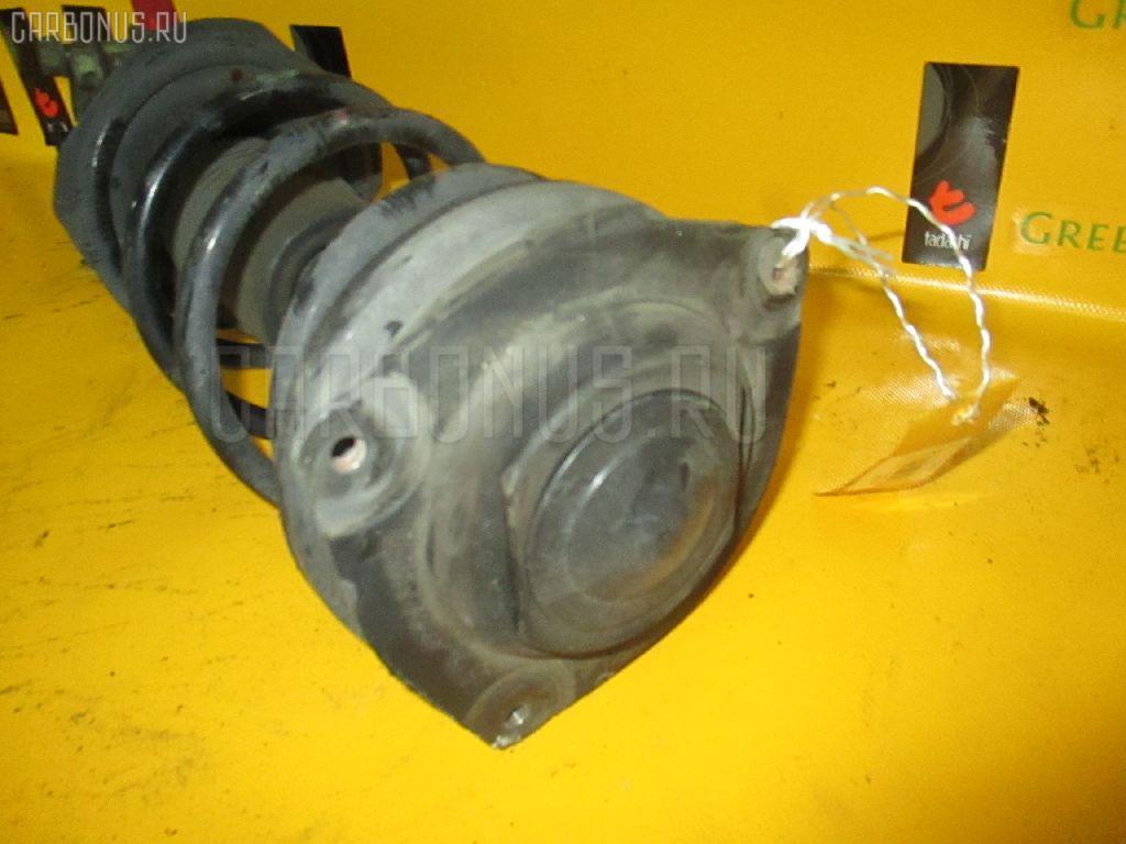Стойка амортизатора Nissan Tiida latio SC11 HR15DE Фото 1