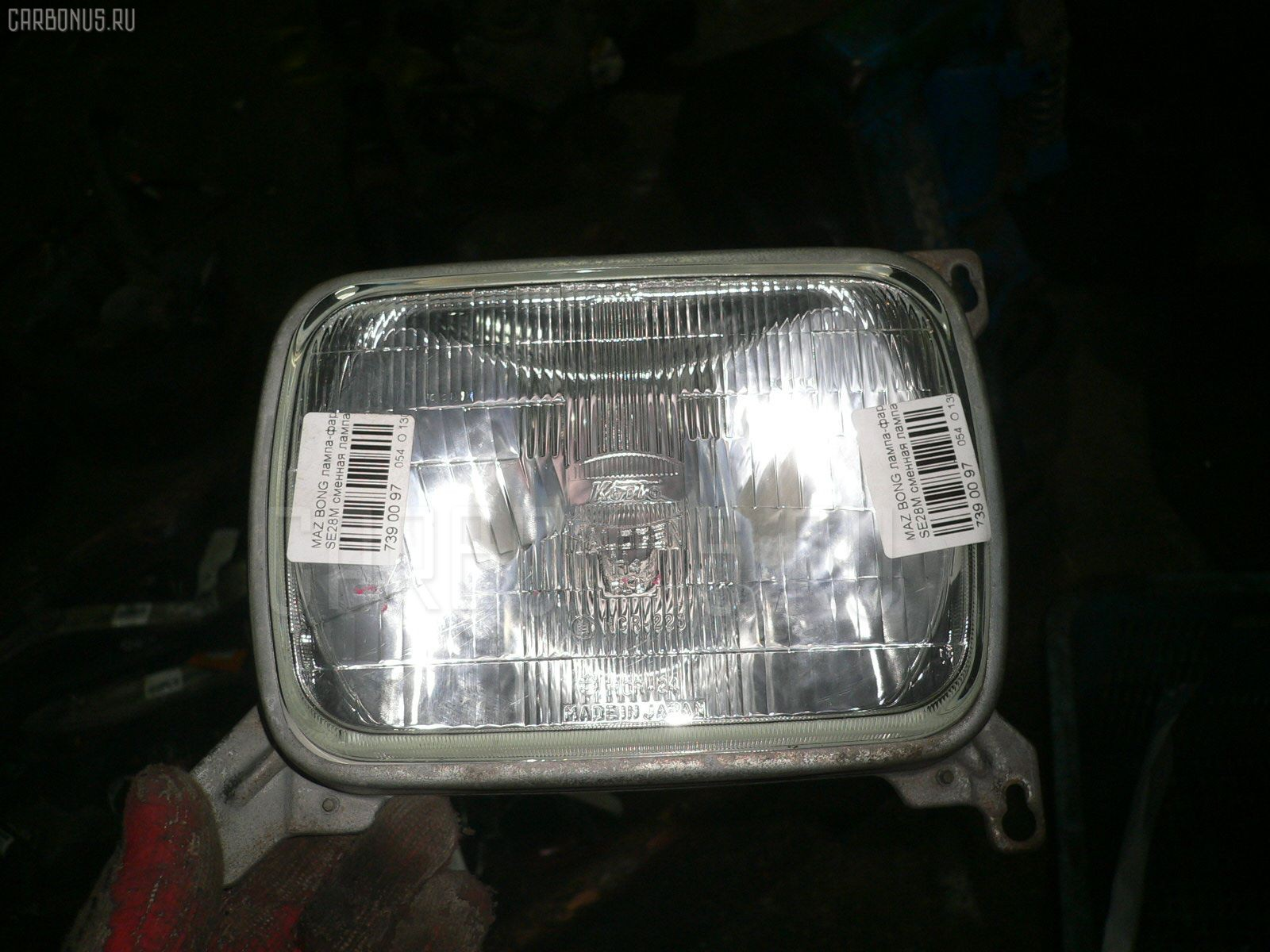 Лампа-фара Mazda Bongo SE28M Фото 1