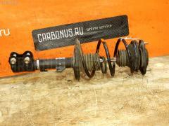 Стойка амортизатора Toyota Corolla runx NZE121 1NZ-FE Фото 1