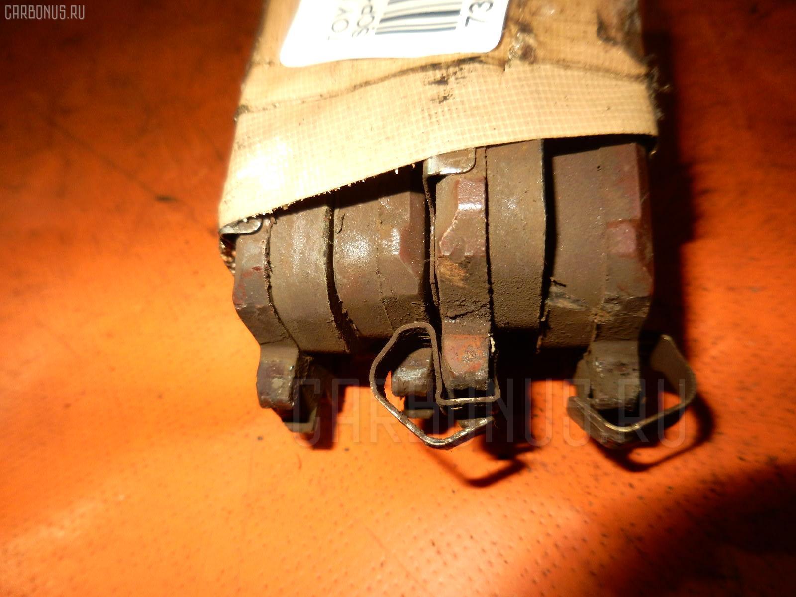 Тормозные колодки TOYOTA RACTIS SCP100 2SZ-FE. Фото 2