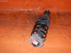Стойка амортизатора VOLVO V70 II SW B5244S 8667250A Переднее Левое