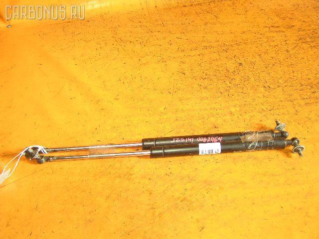 Амортизатор капота TOYOTA CROWN JZS141. Фото 3
