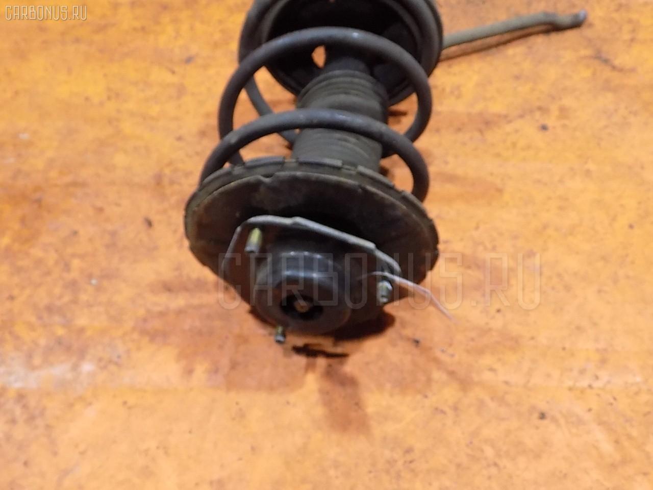 Стойка амортизатора Nissan Teana J31 VQ23DE Фото 1