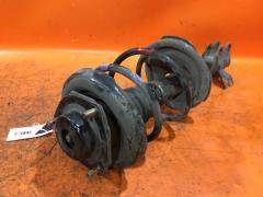 Стойка амортизатора на Nissan X-Trail T30 QR20DE, Переднее Левое расположение
