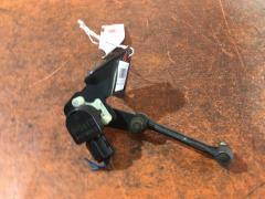 Датчик регулировки наклона фар на Suzuki Escudo TDA4W 021714, Переднее расположение