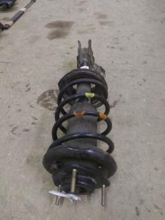 Стойка амортизатора на Nissan Wingroad WFY10 GA15DE Фото 2