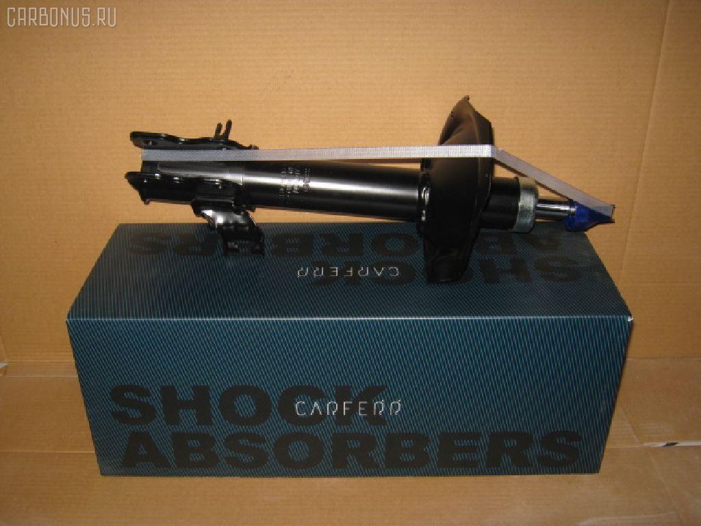 Стойка амортизатора CARFERR CR-049FR-NT30, 334360 на Nissan X-Trail T30 QR20DE Фото 1