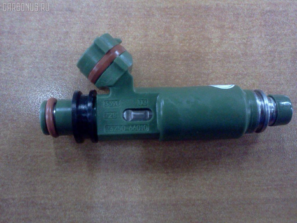 Форсунка инжекторная TOYOTA LAND CRUISER FZJ100L 1FZ-FE. Фото 2