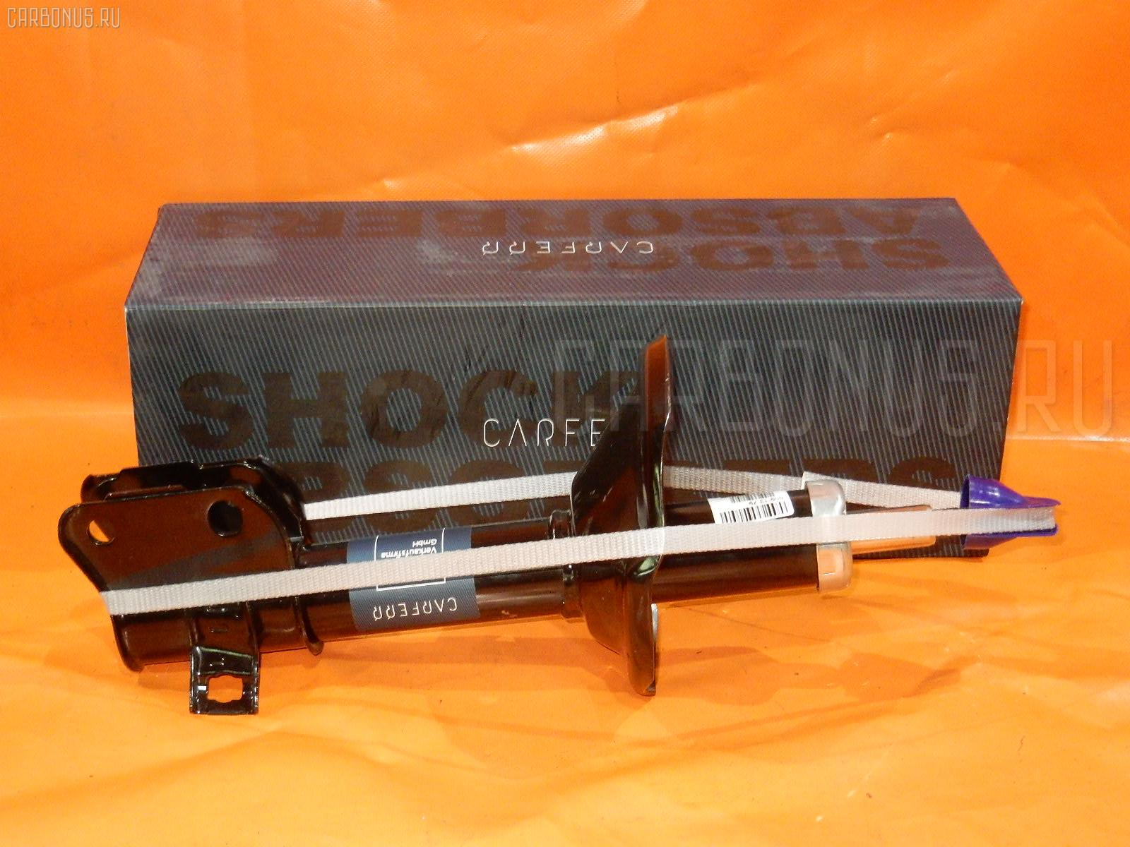 Стойка амортизатора Subaru Forester SF5 Фото 1