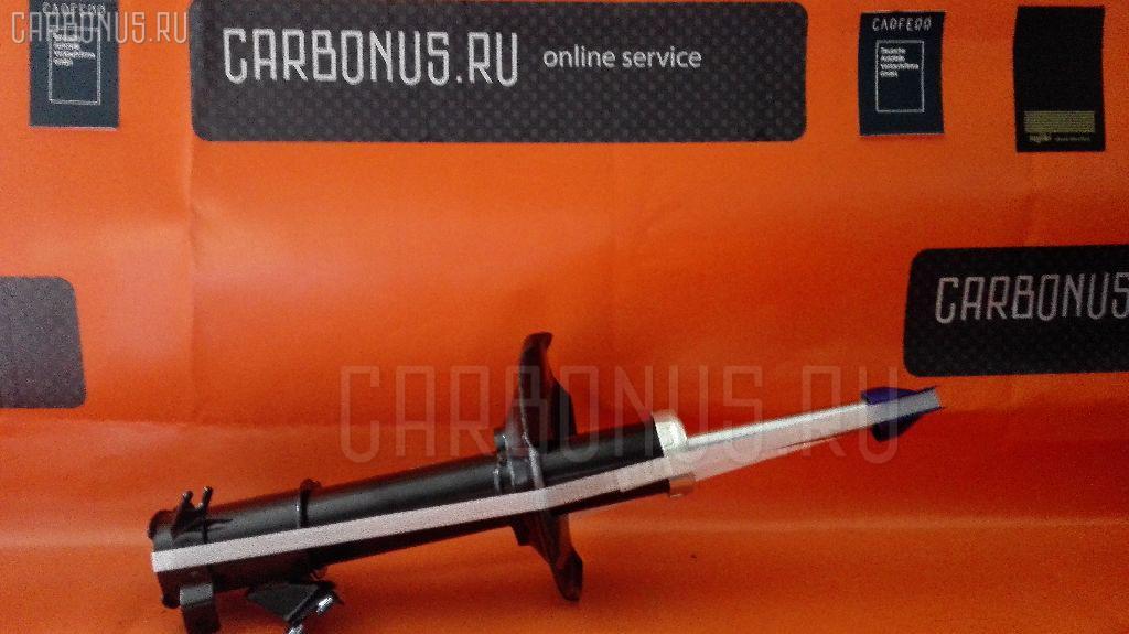 Стойка амортизатора CARFERR CR-049FL-A32, 334481 на Nissan Cefiro A32 Фото 1