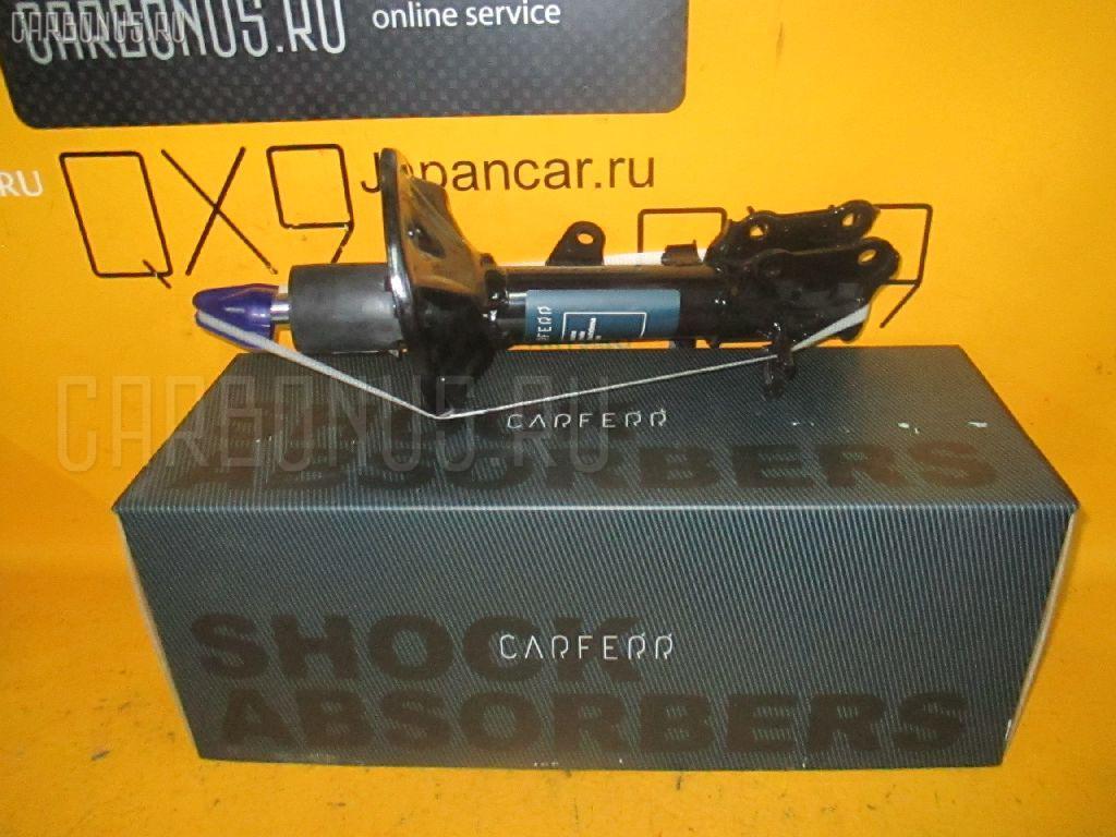 Стойка амортизатора Kia Cerato LD Фото 1