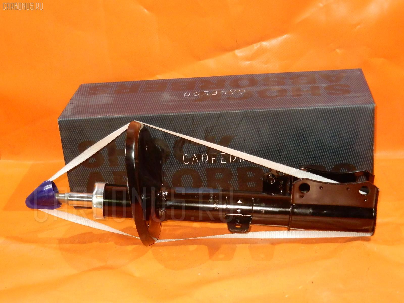 Стойка амортизатора CARFERR CR-049RR-SV40 на Toyota Camry SV40 Фото 1