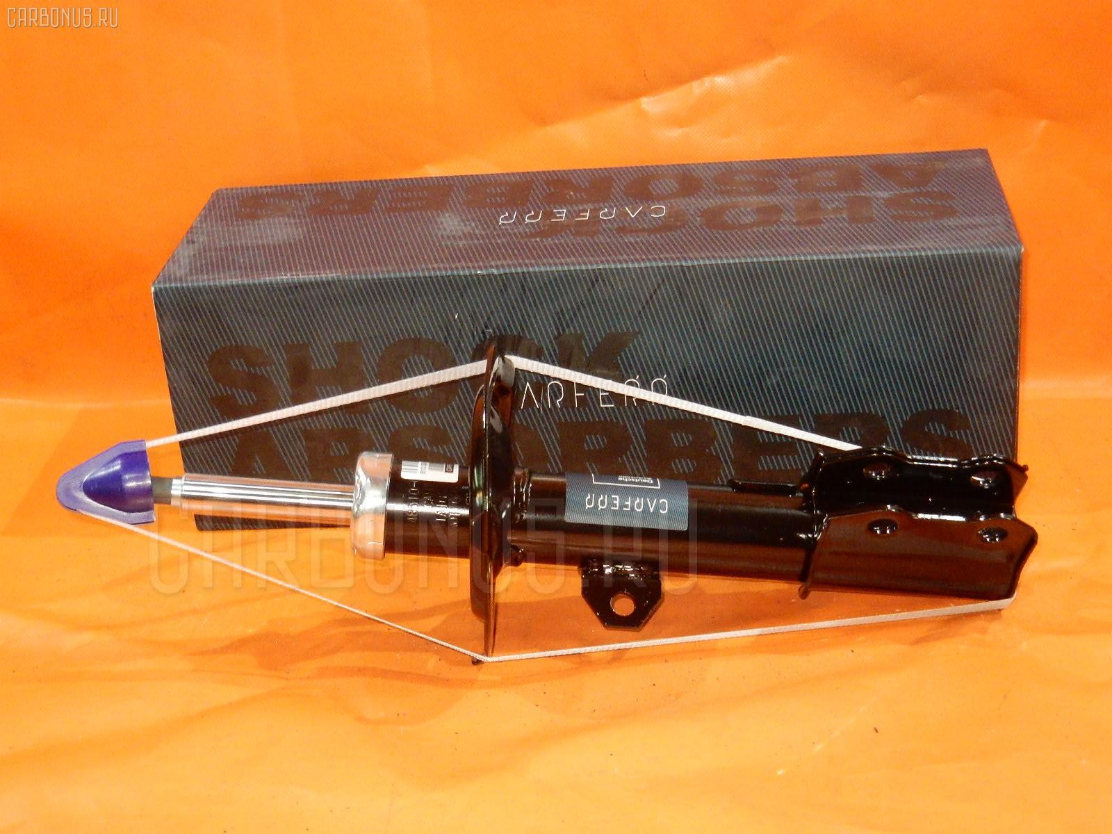 Стойка амортизатора TOYOTA COROLLA NZE121 Фото 1
