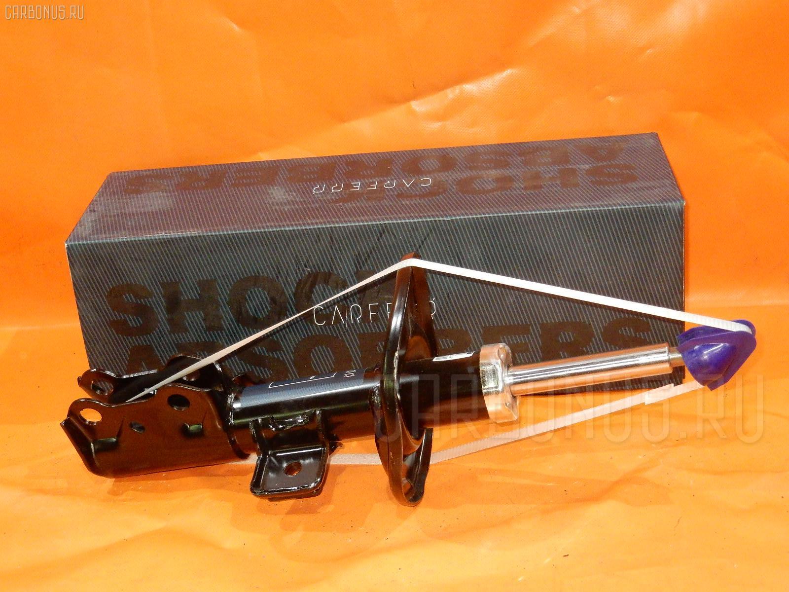 Стойка амортизатора CARFERR на Toyota Auris ZRE186H Фото 1