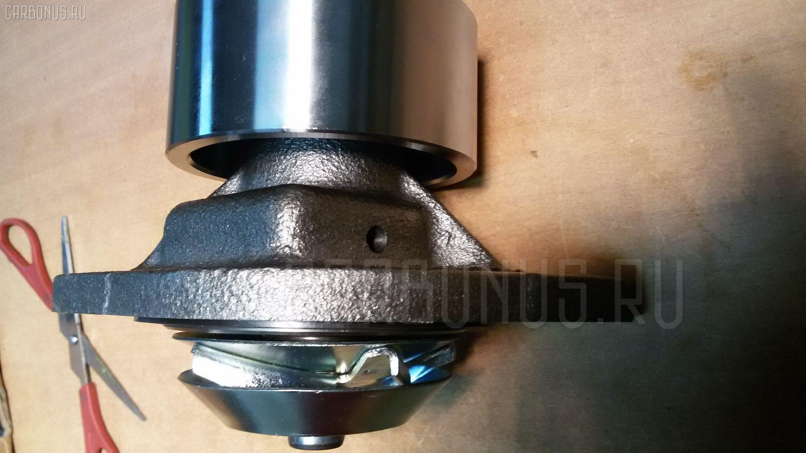 Помпа KOMATSU PC200-6 S6D102 Фото 6