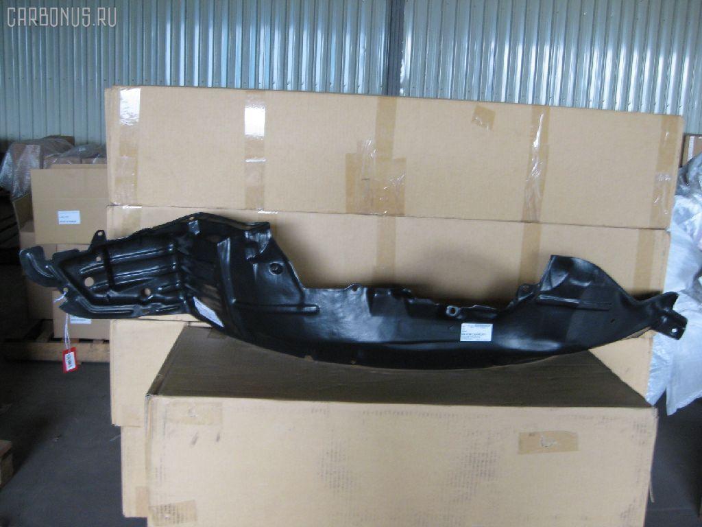 Подкрылок NISSAN CEFIRO A33 VQ20DE. Фото 2