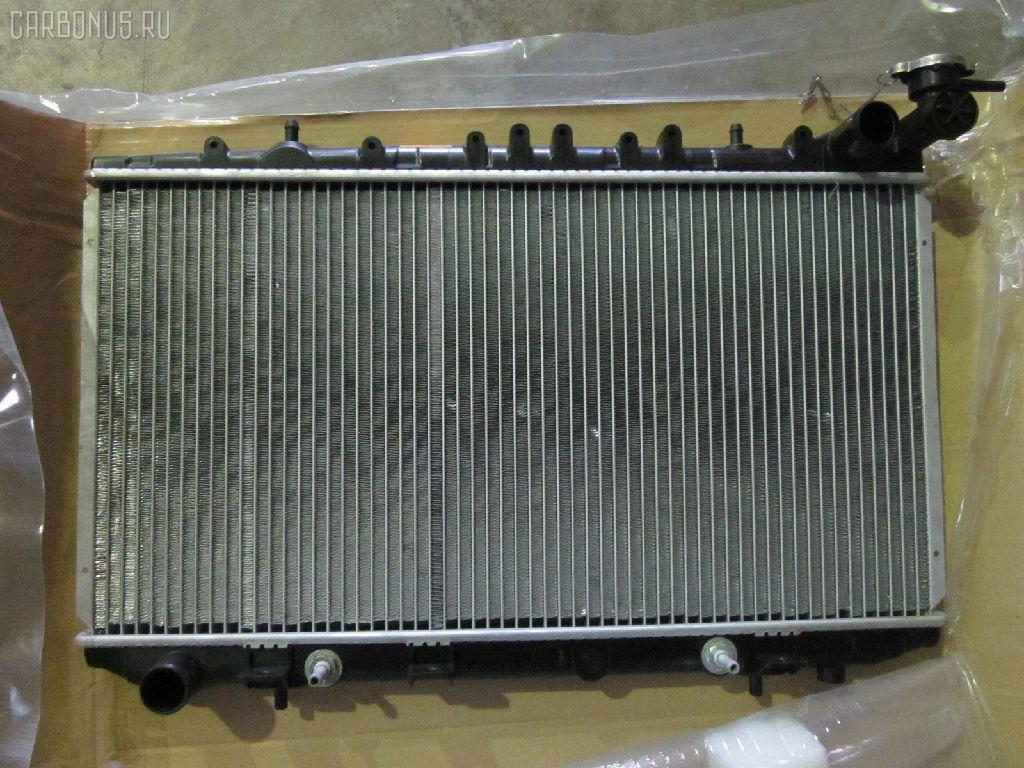 Радиатор ДВС NISSAN AVENIR PNW10 SR20DE. Фото 1